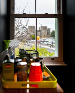Breathtaking view of Conwy castle through the window of a boutique bed and breakfast in conwy, north wales
